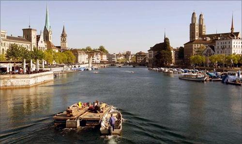 A pontoon sails down Zurich's Limmat River.
