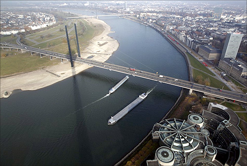 Ships pass the Rhine river with a partially dried-up riverbed in the western town of Dusseldorf.