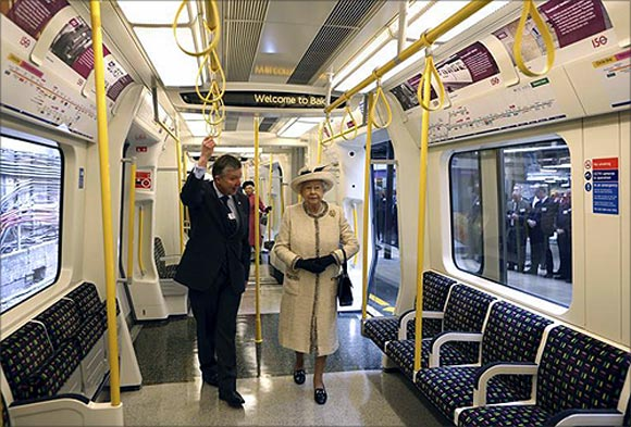 Britain's Queen Elizabeth speaks with Mike Brown, managing director of London Underground, as she inspects a tube train during her visit to Baker Street underground station in London.