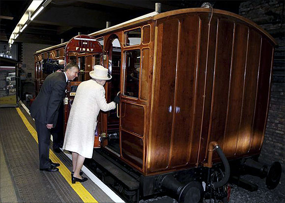 -Britain's Queen Elizabeth views a vintage carriage with Mike Brown, managing director of London Underground.
