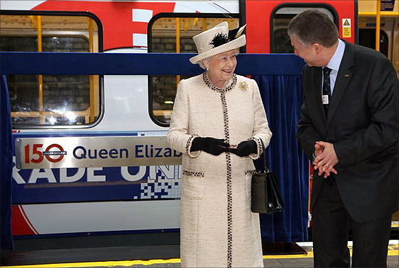 Britain's Queen Elizabeth speaks with Mike Brown, managing director of London Underground.