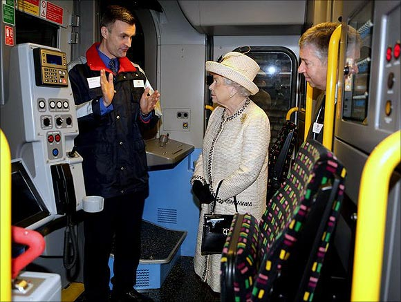 Britain's Queen Elizabeth is shown the drivers cabin of a tube train during a visit to Baker Street Underground Station in London.