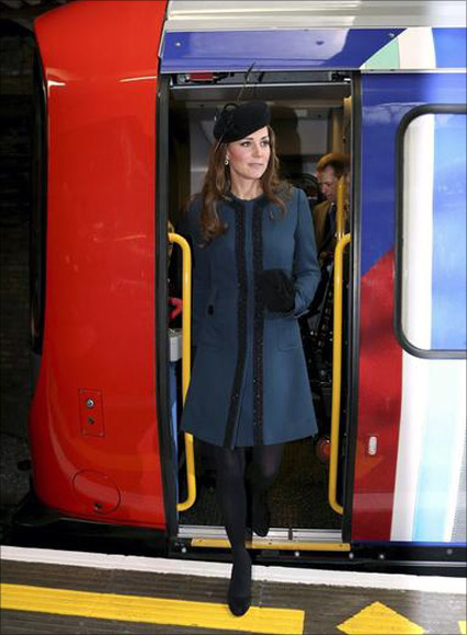 Britain's Catherine, Duchess of Cambridge inspects a tube train during her visit to Baker Street underground station.