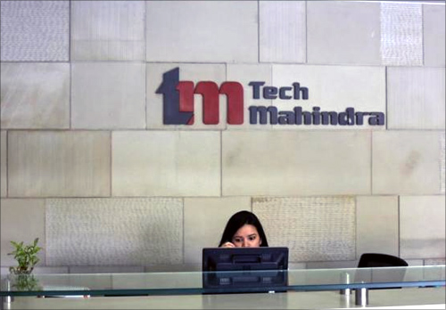 An employee sits at the front desk inside Tech Mahindra office building in Noida on the outskirts of New Delhi.