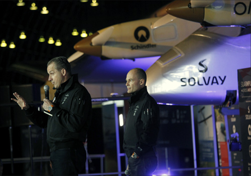 Solar Impulse pilots Andre Borschberg (L) and Bertrand Piccard talk near the aircraft at Moffett Field in Mountain View, California.