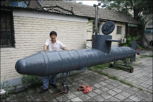 Tao Xiangli stands beside his homemade submarine in a courtyard in Beijing.
