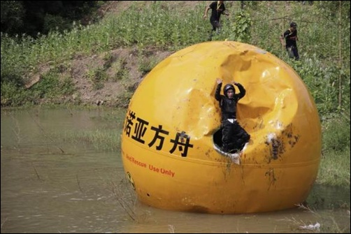 A Chinese inventor, Yang Zongfu celebrates on his six-ton (5,443 kg) ball container named Noah's Ark of China after he succeeds in a series of tests of the vessel in Yiwu, Zhejiang province.