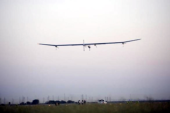 Solar Impulse aircraft takes off from Moffett Field to begin the first leg of its 2013 Across America Mission in Mountain View, California.