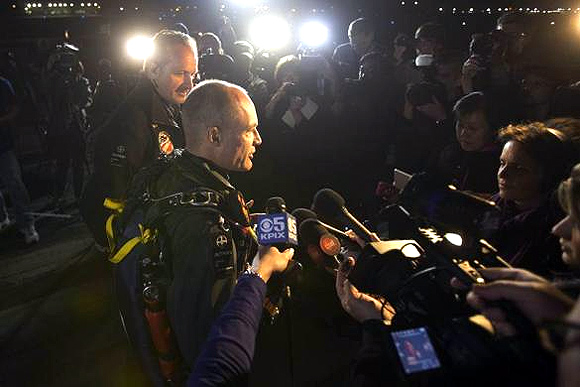 Solar Impulse pilots Andre Borschberg (L) and Bertrand Piccard speaks to members of the media before Bertrand takes off from Moffett Field to begin the first leg of their 2013 Across America Mission in Mountain View, California.