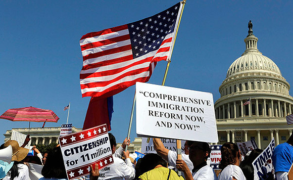 People rally for comprehensive immigration reform April 10 near the US Capitol in Washington.