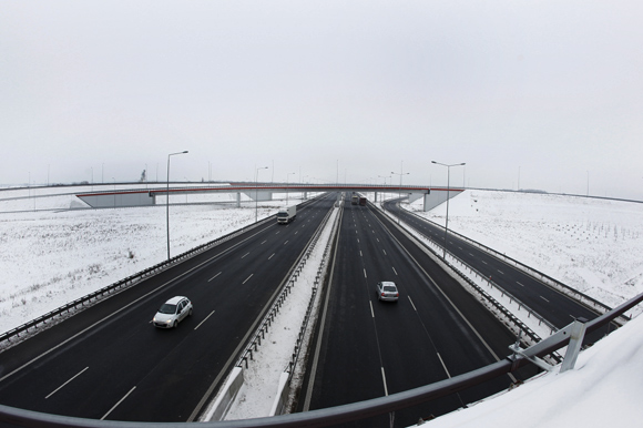Cars travel on the A2 highway linking Warsaw with Western Europe close to the junction with highway A1 outside the town of Strykow.