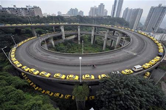 Taxis line up to get their tanks filled on a ramp in Chongqing municipality.