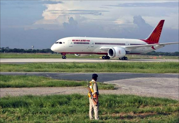 A security personnel stands guard as Air India'