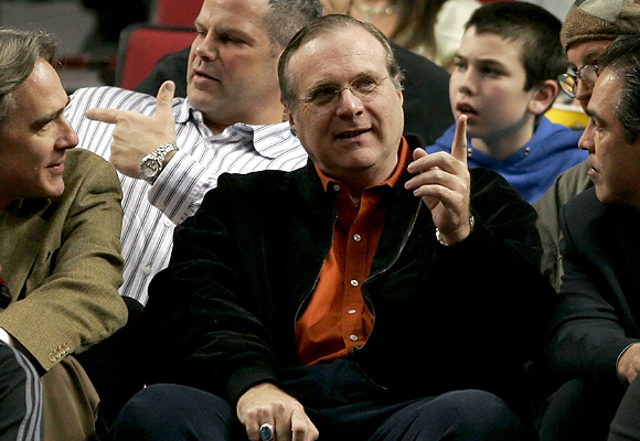 Portland Trail Blazers owner and billionaire Paul Allen (C) talks to the team president Steve Patterson (L) in front of fans during the team's NBA game against the Los Angeles Clippers in Portland, Oregon, in this March 26, 2006 file photo.