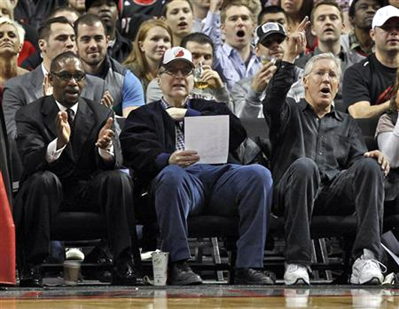 Portland Trail Blazers owner Paul Allen (C) watches game with Seattle Seahawks coach Pete Carroll (R) and Trail Blazers president Larry Miller (L) during first quarter of NBA basketball game against the Utah Jazz in Portland, Oregon, in this April 18, 2012 file photo.