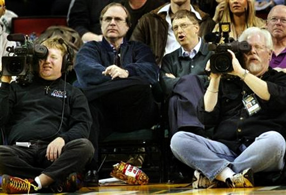 Microsoft co-founders Bill Gates and Paul Allen watch an NBA game at Key Arena in Seattle.