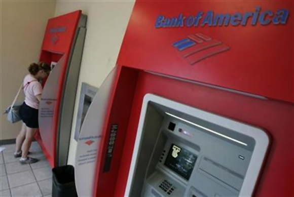 A woman uses an automated teller machine at a Bank of America branch in Chicago.