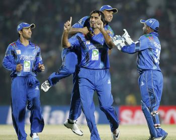 Shahpoor Zadran celebrates after picking up a wicket