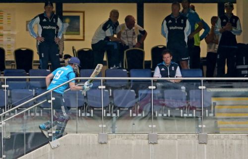 Jos Buttler of England looks dejected as he makes his way back to the changing room after being run out at the non strikers end by Sachithra Senanayake