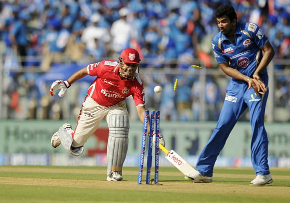 Virender Sehwag is run-out by Rohit Sharma