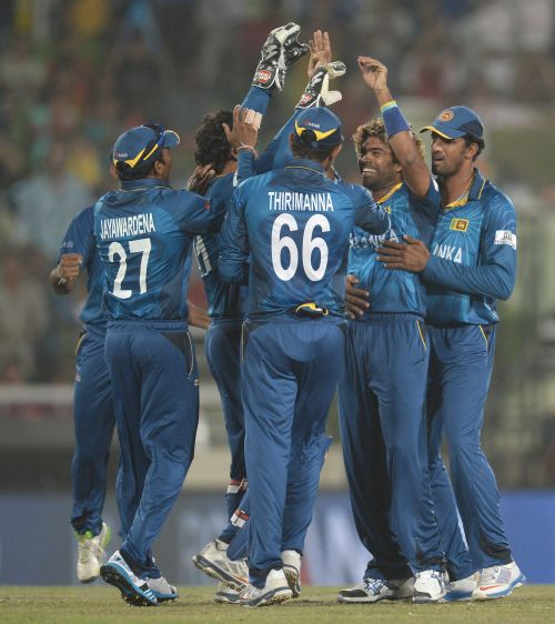 Sri Lankan players celebrate after picking a wicket