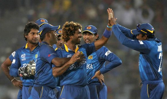 Lasith Malinga celebrates after picking up a wicket