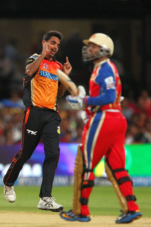 Bhuvneshwar Kumar celebrates after dismissing Parthiv Patel