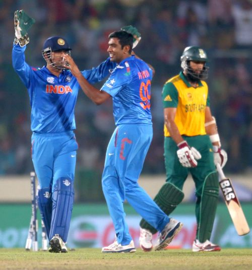Ravichandran Ashwin celebrates after picking the wicket of Hashim Amla