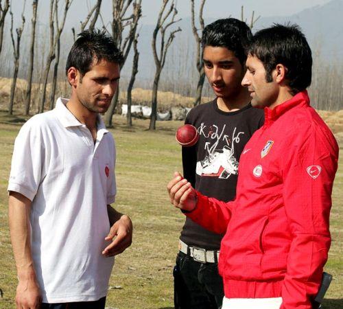 Parvez Rasool, right, with team mates.