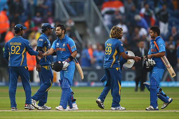 Indian players shake hands with Sri Lankan players after a match