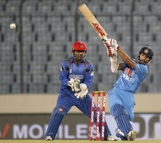 Shikhar Dhawan hits one for a boundary