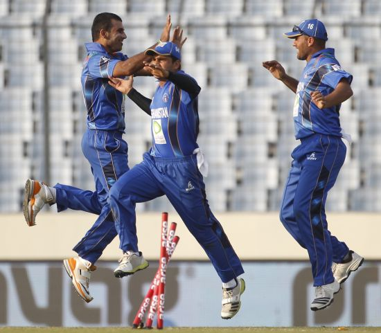 Afghanistan players celebrate after picking up a wicket