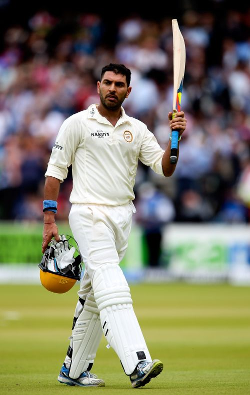 Yuvraj Singh celebrates after completing his century