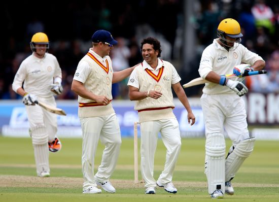 Sachin Tendulkar celebrates after dismissing Yuvaj Singh