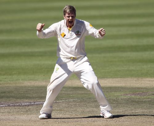 Steven Smith celebrates after picking up a wicket