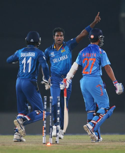 Angelo Mathews celebrates after dismissing Ajinkya Rahane