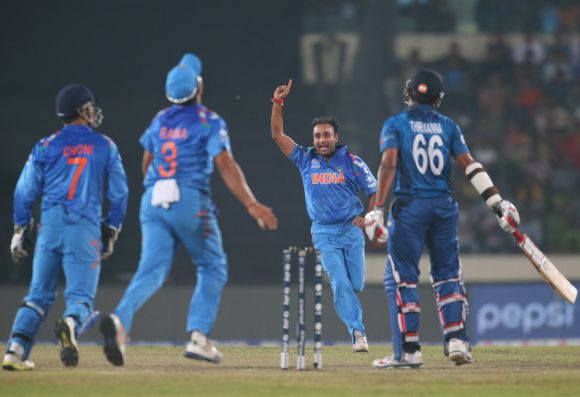 Amit Mishra celebrates after picking the wicket of Lahiru Thirimanne