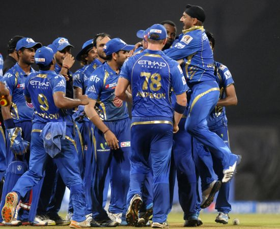 Harbhajan Singh celebrates with his Mumbai teammates
