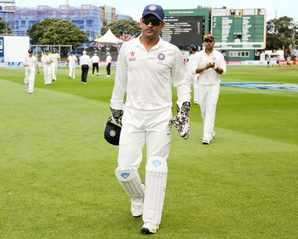 Mahendra Singh Dhoni leads the team out in a Test match