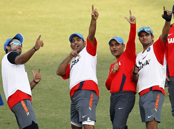 Mahendra Singh Dhoni and his India teammates