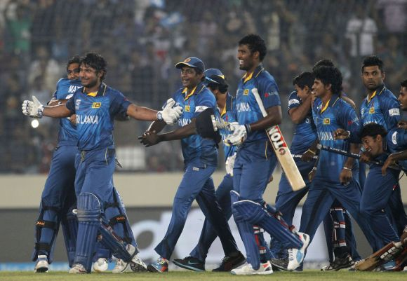 Sri Lankan players hug each other after winning the World T20