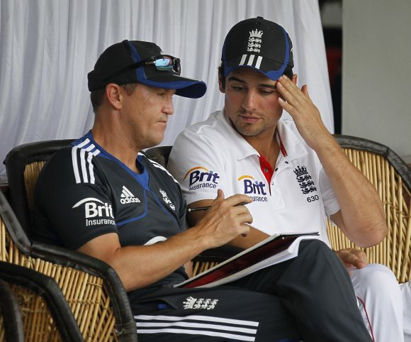Andy Flower, then the English coach, and skipper Alistair Cook.