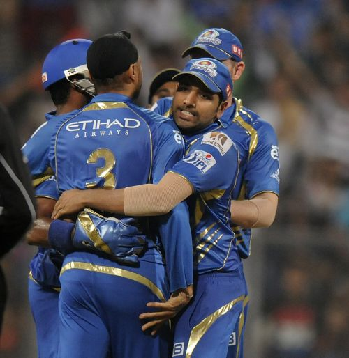 Rohit Sharma celebrates after a fall of a wicket
