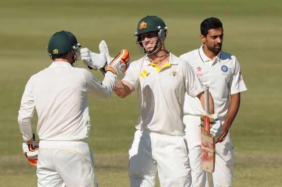 Mitchell Marsh of Australia 'A' celebrates scoring his century with Sam Whiteman