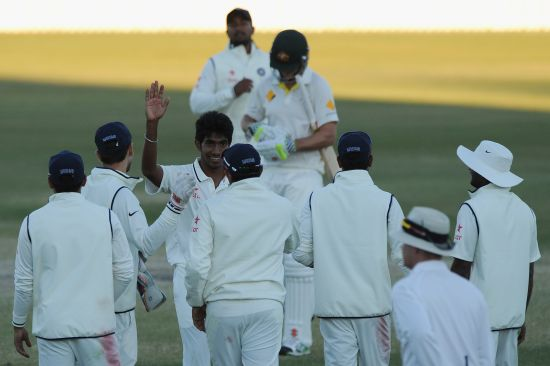 Jasprit Bumrah of India A celebrates with team-mates the wicket of Mitchell Marsh of Australia A