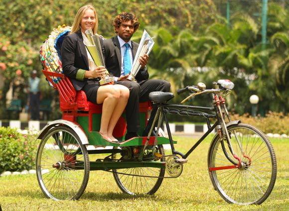 Meg Lanning, captain of Australia and Lasith Malinga, captain of Sri Lanka pose with the trophies on a rickshaw