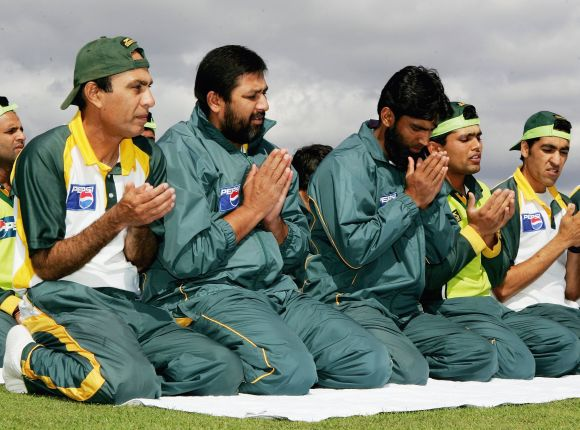 Inzamam-ul-Haq, second from left, in prayer.