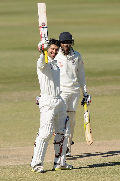 Naman Ojha celebrates after completing his century