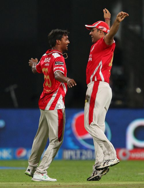 Sandeep Sharma celebrates after dismissing Chris Gayle