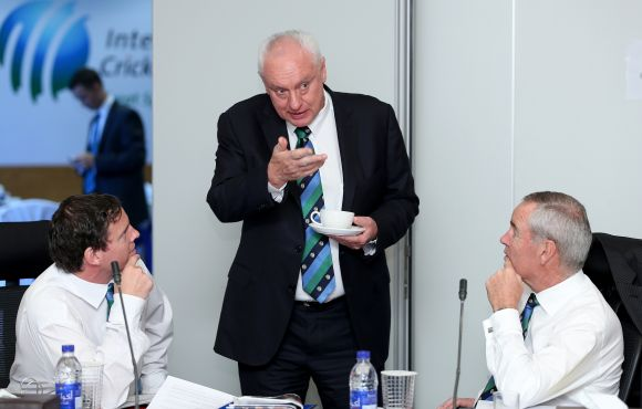 Cricket Australia chairman Wally Edwards (centre) talks with Alan Isaac (right), president of the ICC and Iain Higgins (left) ,Head of Legal at the ICC during the ICC Board Meeting